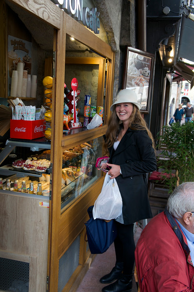 Cecelia getting a drink at a café in Annecy