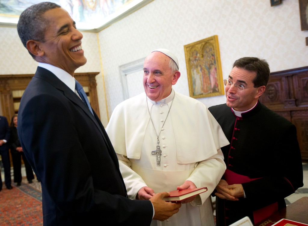 ". FILE - In this Thursday, March 27, 2014 file photo, U.S. President Barack Obama, left, reacts as he meets with Pope Francis, center, during their exchange of gifts at the Vatican. When Pope Francis meets with President Donald Trump at the Vatican May 24, the world will be watching how the Argentine ""slum pope\"" interacts with the brash, New York billionaire-turned-president. (AP Photo/Pablo Martinez Monsivais, File)"