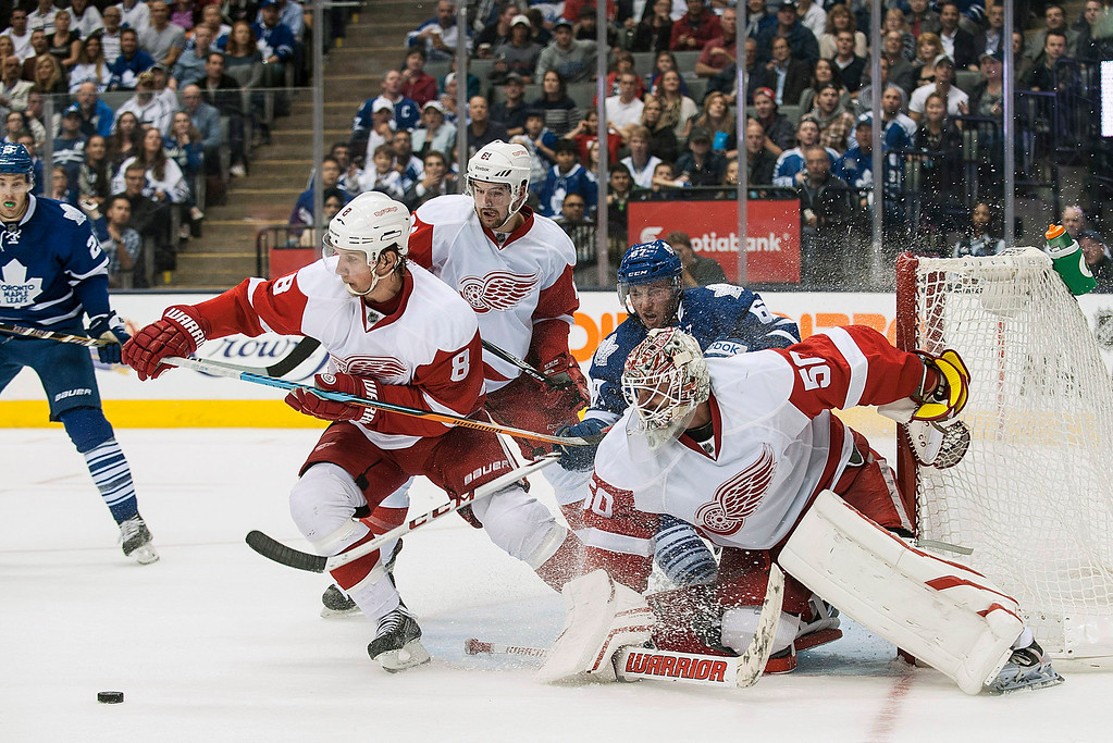 . Detroit Red Wings goalie Jonas Gustavsson (50) stops a Toronto Maple Leafs shot during second-period preseason NHL hockey game action in Toronto, Friday, Oct. 3, 2014. (AP Photo/The Canadian Press, Aaron Vincent Elkaim)