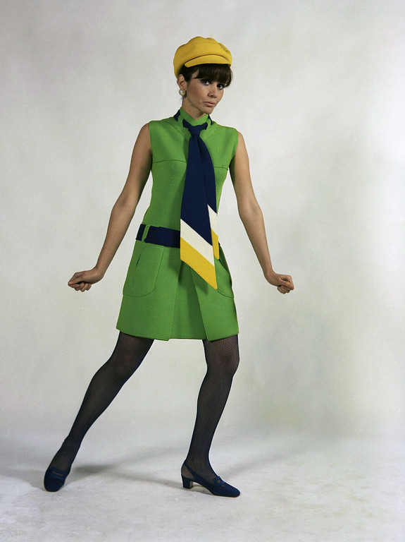 . An original short tunic of sun green jersey, worn with a long, college-type necktie, blue, white and yellow, with a yellow cap, blue belt, and black stockings. A creation of Albertina house of Rome, presented at Florence, Jan. 18, 1967. (AP Photo)