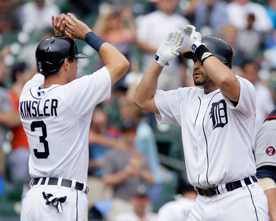 . Detroit Tigers\' J.D. Martinez, right, celebrates his three-run home run with Ian Kinsler (3) during the sixth inning of a baseball game against the Cleveland Indians Sunday, June 14, 2015, in Detroit. (AP Photo/Duane Burleson)