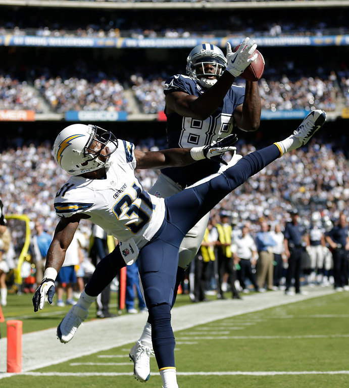 . Dallas Cowboys wide receiver Dez Bryant catches a touch down pass as San Diego Chargers defensive back Richard Marshall looks on during the first half of an NFL football game Sunday, Sept. 29, 2013, in San Diego. (AP Photo/Gregory Bull)