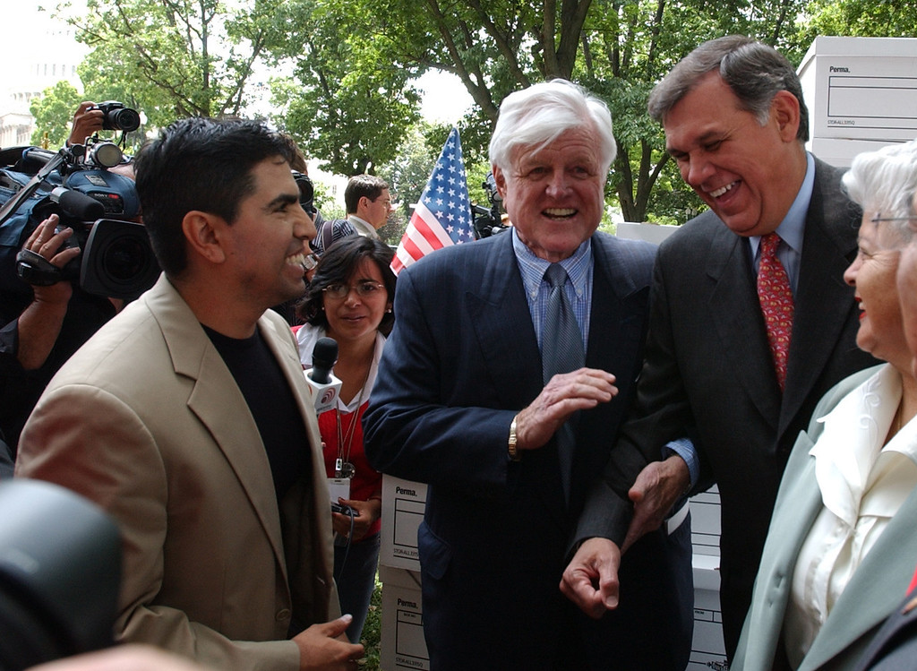 ". Sen. Edward Kennedy, D-Mass., center, chats with with Sen. Mel Martinez, R-Fla., right, Los Angeles radio host Eddie ""El Piolin\"" Sotelo, left, and others, on Capitol Hill in Washington, Thursday, June 14, 2007, prior to a news conference on immigration reform.  (AP Photo/Dennis Cook)"