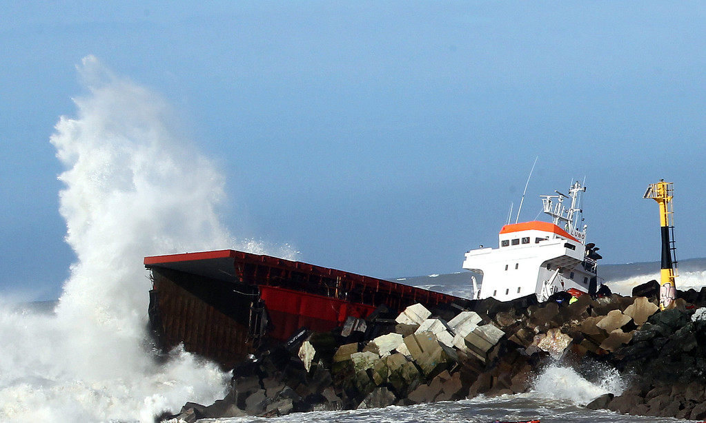 """. Waves knock against the wreck of the Spanish cargo ship \""""Luno\"""" that slammed into a jetty in choppy Atlantic Ocean waters and broke in two, off Anglet, southwestern France, Wednesday, Feb. 5, 2014.  (AP Photo/Bob Edme)"""