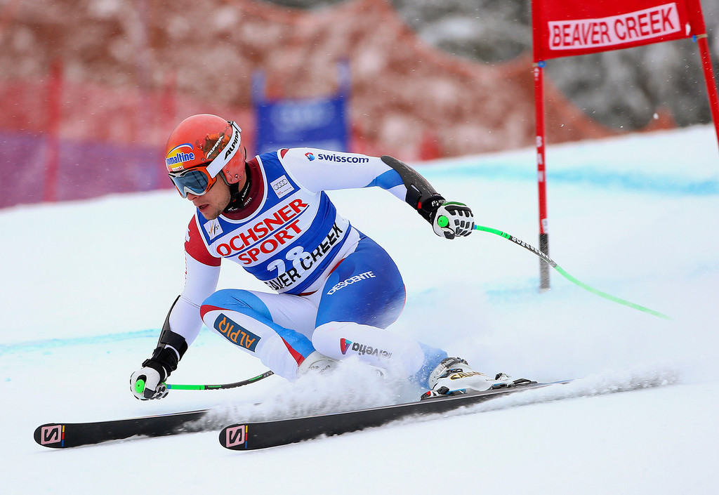 . Switzerland\'s Patrick Kueng makes a turn during the men\'s World Cup super-G skiing event, Saturday, Dec. 7, 2013, in Beaver Creek, Colo. Kueng took first place in the race. (AP Photo/ Alessandro Trovati)