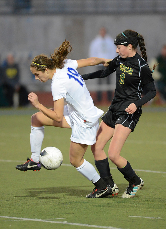 . Westlake\'s Nicole Molen tries to keep the ball from Mira Costa\'s Megan Carver, 9, during quarterfinal action.  Westlake defeated Mira Costa 1-0 in the quarterfinal.  Photo by David Crane/Staff Photographer