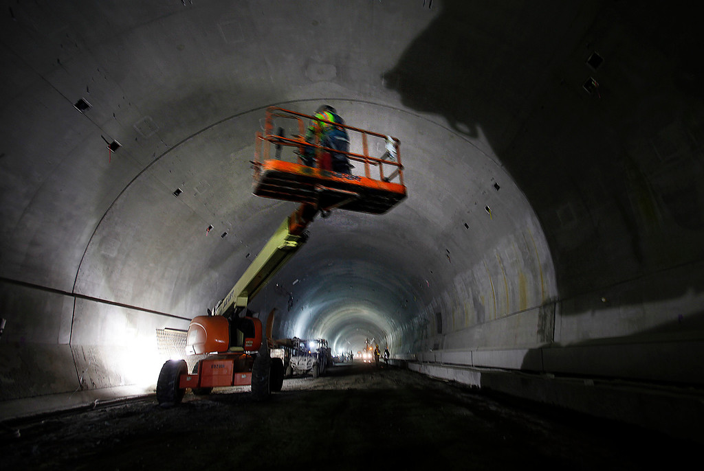 . A cherry picker casts a shadow along the long walls of the Caldecott Tunnel fourth bore project Friday afternoon Jan. 18, 2013 near Orinda, Calif. The long-awaited project expects to open sometime in the latter part of 2013. (Karl Mondon/Staff)