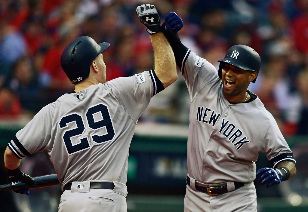 . New York Yankees\' Aaron Hicks, right, is congratulated by Todd Frazier after Hicks hit a three-run home run during the third inning of Game 2 of baseball\'s American League Division Series, Friday, Oct. 6, 2017, in Cleveland.  (AP Photo/David Dermer)