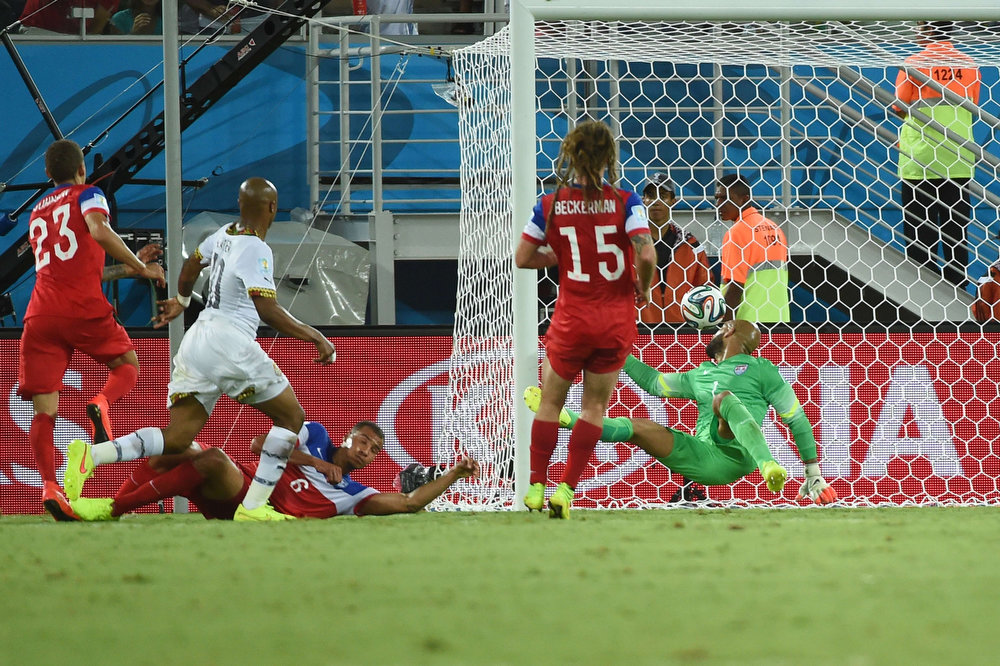 Description of . Ghana's midfielder Andre Ayew (2L) scores during a Group G football match between Ghana and US at the Dunas Arena in Natal during the 2014 FIFA World Cup on June 16, 2014.  AFP PHOTO / EMMANUEL DUNANDEMMANUEL DUNAND/AFP/Getty Images