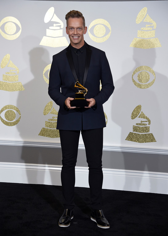 ". Bernie Herms poses in the press room with the award for best contemporary christian music performance/song for ""Thy Will\"" by Hillary Scott and the Scott Family at the 59th annual Grammy Awards at the Staples Center on Sunday, Feb. 12, 2017, in Los Angeles. (Photo by Chris Pizzello/Invision/AP)"