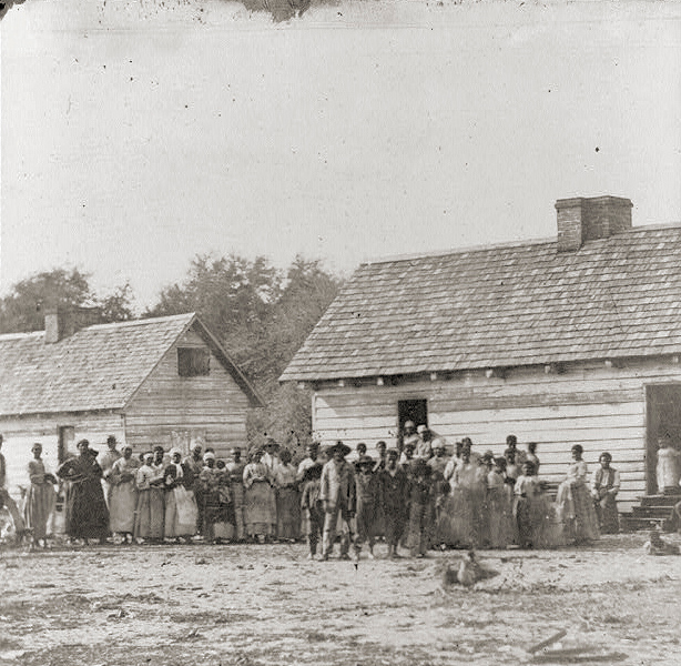 . Large group of slaves(?) standing in front of buildings on Smith\'s Plantation, Beaufort, South Carolina. 1862. Timothy H. O\'Sullivan, photographer . Library of Congress