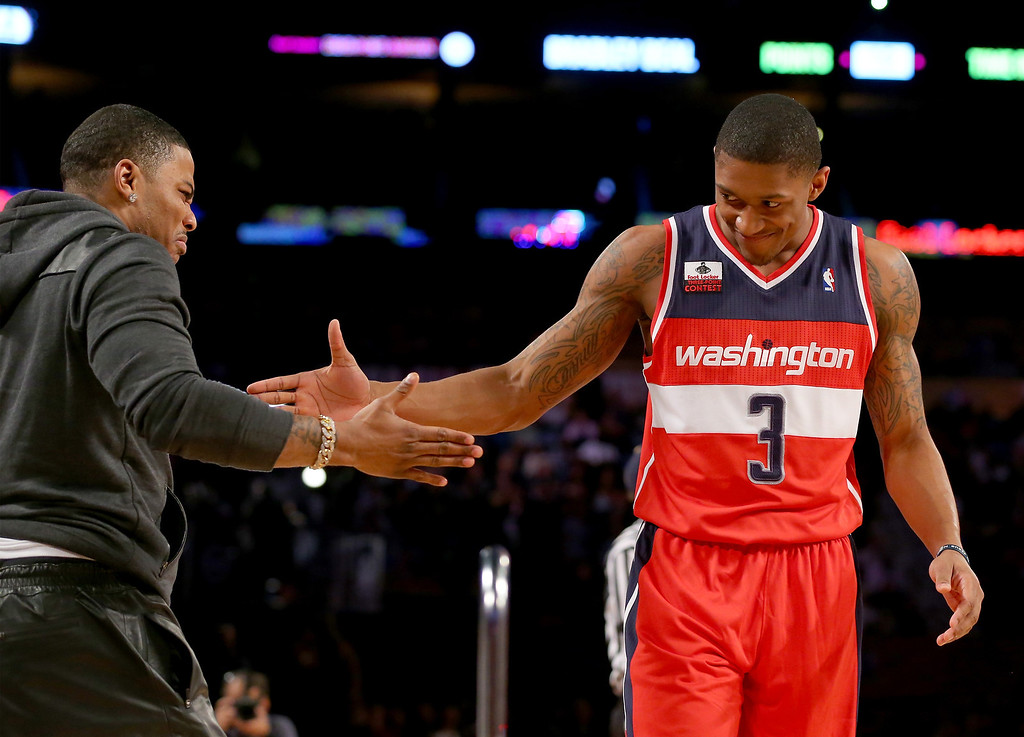 . NEW ORLEANS, LA - FEBRUARY 15:  Eastern Conference All-Star Bradley Beal #3 of the Washington Wizards celebrates with Nellie during the Foot Locker Three-Point Contest 2014 as part of the 2014 NBA All-Star Weekend at the Smoothie King Center on February 15, 2014 in New Orleans, Louisiana. (Photo by Ronald Martinez/Getty Images)
