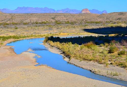 The Rio Grande is like a blue ribbon running through the desert at Santa Elena Canyon in Big Bend National Park