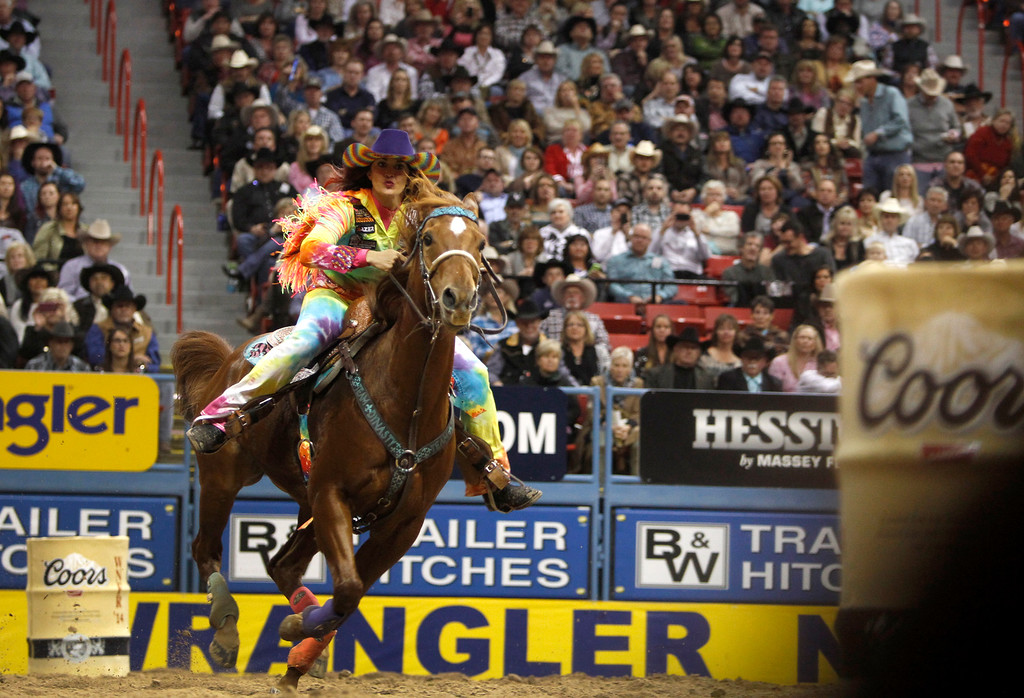 . Fallon Taylor of Whitesboro, Texas rides during the first go-round of the Wrangler National Finals Rodeo in Las Vegas Thursday, Dec. 4, 2014. Taylor\'s time was the best of the night at 14.09 seconds. (AP Photo/Las Vegas Sun, Steve Marcus)