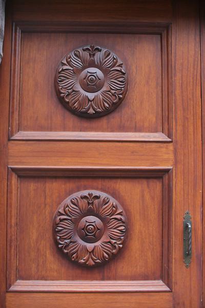Door carving in Quito.