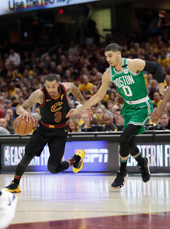 . Cleveland Cavaliers\' George Hill (3) drives past Boston Celtics\' Jayson Tatum (0) in the first half of Game 3 of the NBA basketball Eastern Conference finals, Saturday, May 19, 2018, in Cleveland. (AP Photo/Tony Dejak)
