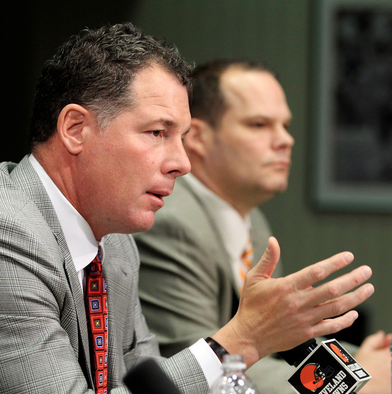. Cleveland Browns head coach Pat Shurmur, left, answers questions as general manager Tom Heckert listens during the NFL football draft at the team\'s training facility, Thursday, April 26, 2012, in Berea, Ohio. The Browns selected Alabama running back Trent Richardson with the third overall pick and Oklahoma State quarterback Brandon Weeden with the 22nd overall pick in the first round. (AP Photo/Tony Dejak)