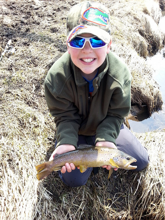 ". Brock Anderson, 10, of Rochester caught this brown trout on the last cast of the day April 6, while fishing with his father Dave in southern Minnesota. ""Brock threw downstream towards a downed tree in the water when this 19-inch trout appeared,\"" Dad reports.  \""He played it well, and I helped him land it, take a few photos, and back into the creek it went.\""  (Photo courtesy of Dave Anderson)"