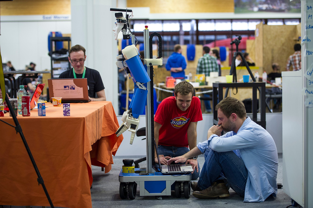 . MAGDEBURG, GERMANY - APRIL 26:  Participants check a service robot at the 2013 RoboCup German Open tournament on April 26, 2013 in Magdeburg, Germany. The three-day tournament is hosting 43 international teams and 158 German junior teams that compete in a variety of disciplines, including soccer, rescue and dance.  (Photo by Jens Schlueter/Getty Images)