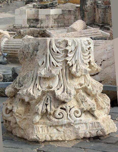 A toppled Corinthian capital.