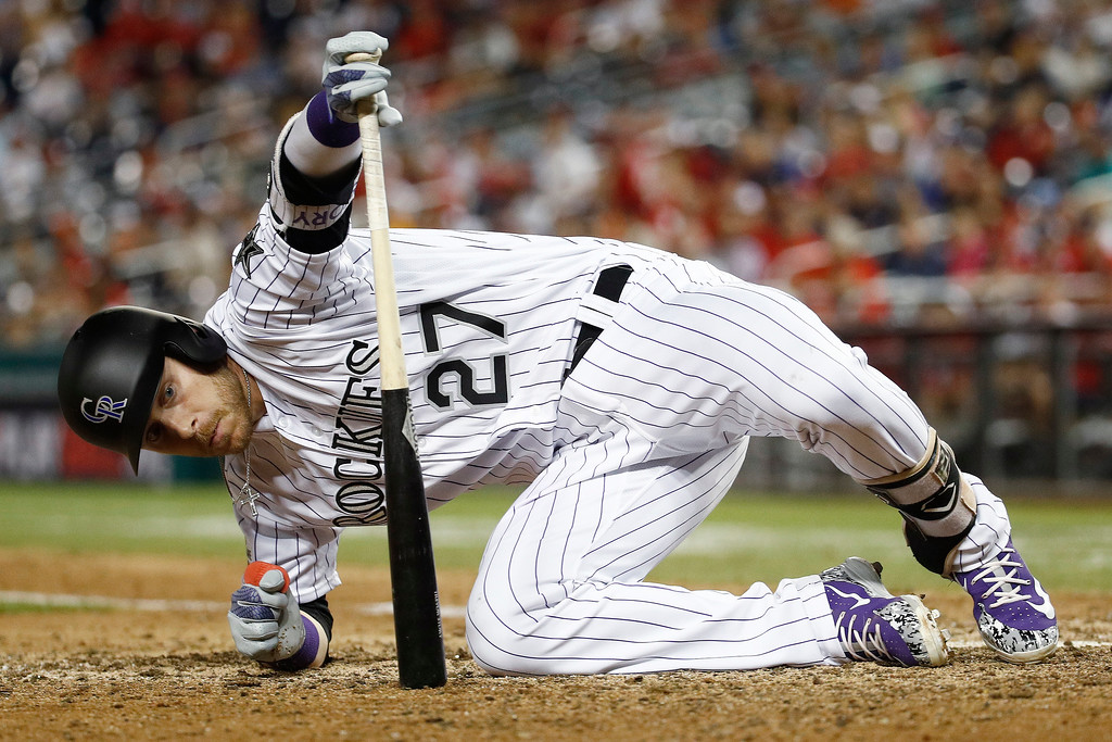 . Colorado Rockies Trevor Story (27) gets up after avoiding a wild pitch in the ninth inning during the Major League Baseball All-star Game, Tuesday, July 17, 2018 in Washington. (AP Photo/Patrick Semansky)