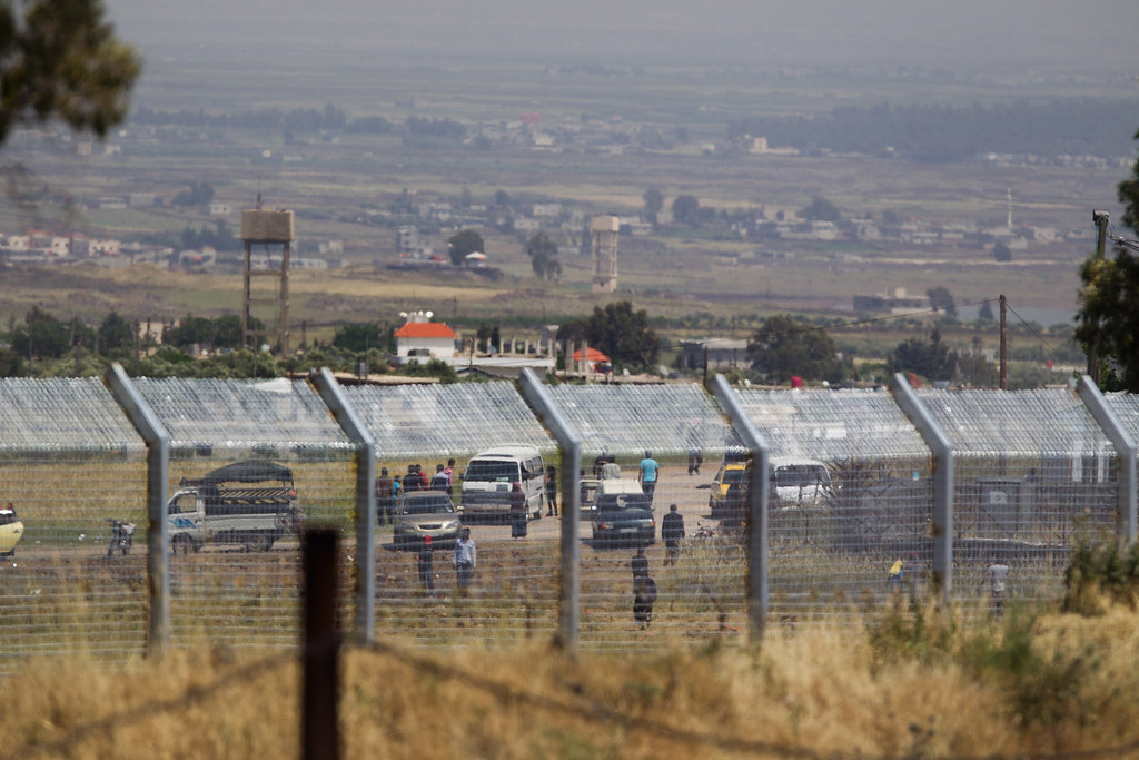 . GOLAN HEIGHTS - MAY 07:  People approach the border fence with Israel near the Syrian village of Al\' Rafide May 7, 2013 in the Israeli-annexed Golan Heights. Syria has accused Israel of launching a series of airstrikes on targets near the Lebanon/Syria border, including an arms shipment and the Jamraya research centre, that was thought to produce chemical weapons.  (Photo by Uriel Sinai/Getty Images)