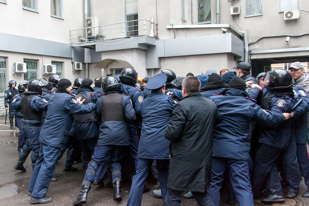 . Ukrainian policemen try to stop pro-Russian protesters from storming the regional government building in the eastern Ukrainian city of Kharkiv on April 13, 2014. Ukraine\'s acting president accused Russia of waging war in his country\'s eastern belt as fresh clashes left at least two dead and led the United Nations Security Council to announce emergency talks late on April 13.   AFP PHOTO/ SERGEY BOBOK/AFP/Getty Images