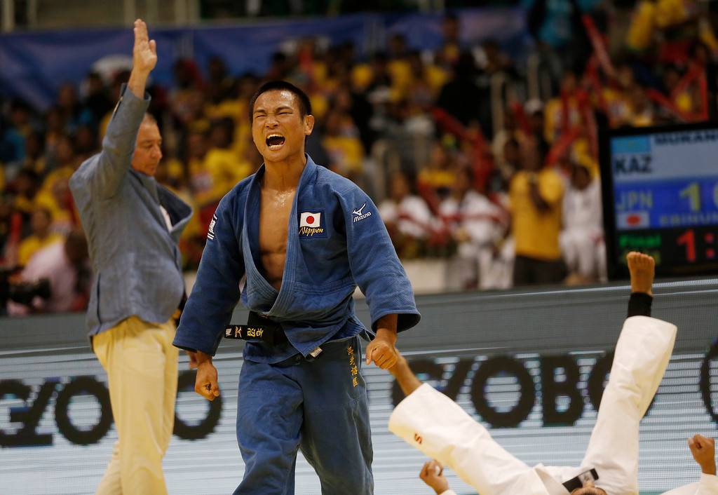. Japan\'s Masashi Ebinuma celebrates his victory over Azamat Mukanov from Kazakhstan after their men\'s - 66 kg final fight at the World Judo Championships in Rio de Janeiro, Brazil, Tuesday, Aug. 27, 2013. Ebinuma won the gold. (AP Photo/Silvia Izquierdo)