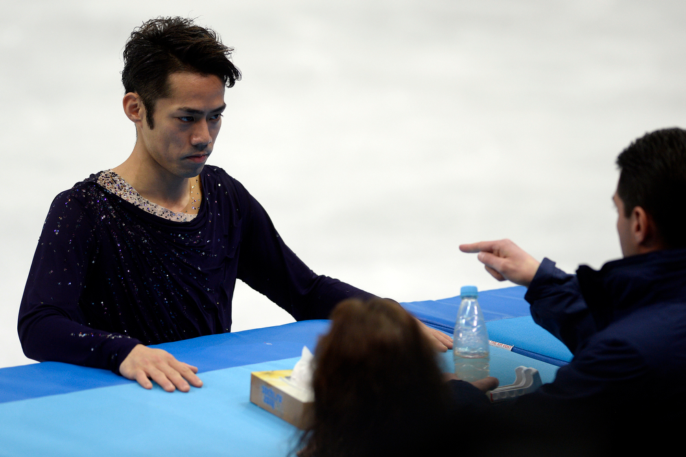 . Japan\'s Daisuke Takahashi prepares for his performance during the men\'s figure skating free skate. Sochi 2014 Winter Olympics on Friday, February 14, 2014. (Photo by AAron Ontiveroz/The Denver Post)
