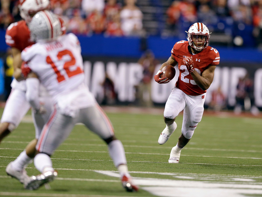 . Wisconsin running back Jonathan Taylor runs with the ball during the second half of the Big Ten championship NCAA college football game against Ohio State, Saturday, Dec. 2, 2017, in Indianapolis. (AP Photo/AJ Mast)