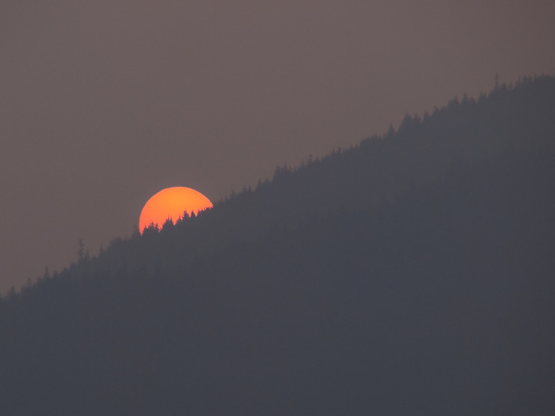 Perhaps not a print you would want, but instructive. When the weather is dry in summer (sometimes) the fires start to burn in Canada and interior Alaska. We often get some of the smoke that blows over. The sun is setting behind Mount McGinnis, near the Mendenhall glacier. August 8th, 2009.