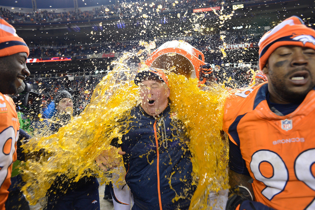 . Denver Broncos head coach John Fox gets doused at the end of the game as the Denver Broncos took on the Kansas City Chiefs at Sports Authority Field at Mile High in Denver, Colorado, in December 2012.  Fox was hospitalized on Saturday, November 3, 2013,  he fell ill during a golf outing with family and friends in Charlotte, North Carolina.  Team sources say it is expected that operations director John Elway will name Jack Del Rio as interim head coach while John Fox undergoes heart surgery.(John Leyba, The Denver Post)