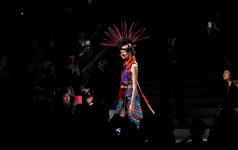 . A model wears a creation for Indian fashion designer Manish Arora\'s fall-winter 2015-2016 ready-to-wear fashion collection  as part of the Paris Fashion Week, presented in Paris, France, Thursday, March 5, 2015. (AP Photo/Christophe Ena)