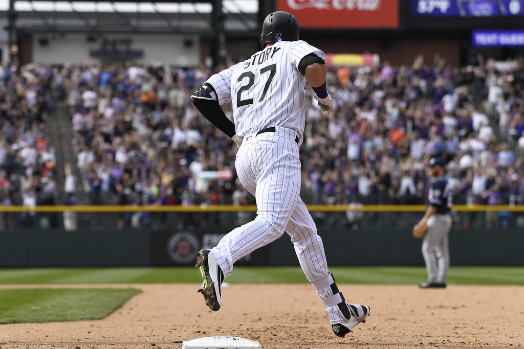 . Trevor Story (27) of the Colorado Rockies runs the bases after hitting a home run in the fourth inning. The Colorado Rockies played the San Diego Padres Friday, April 8, 2016 on opening day at Coors Field in Denver, Colorado. (Photo By Andy Cross/The Denver Post)