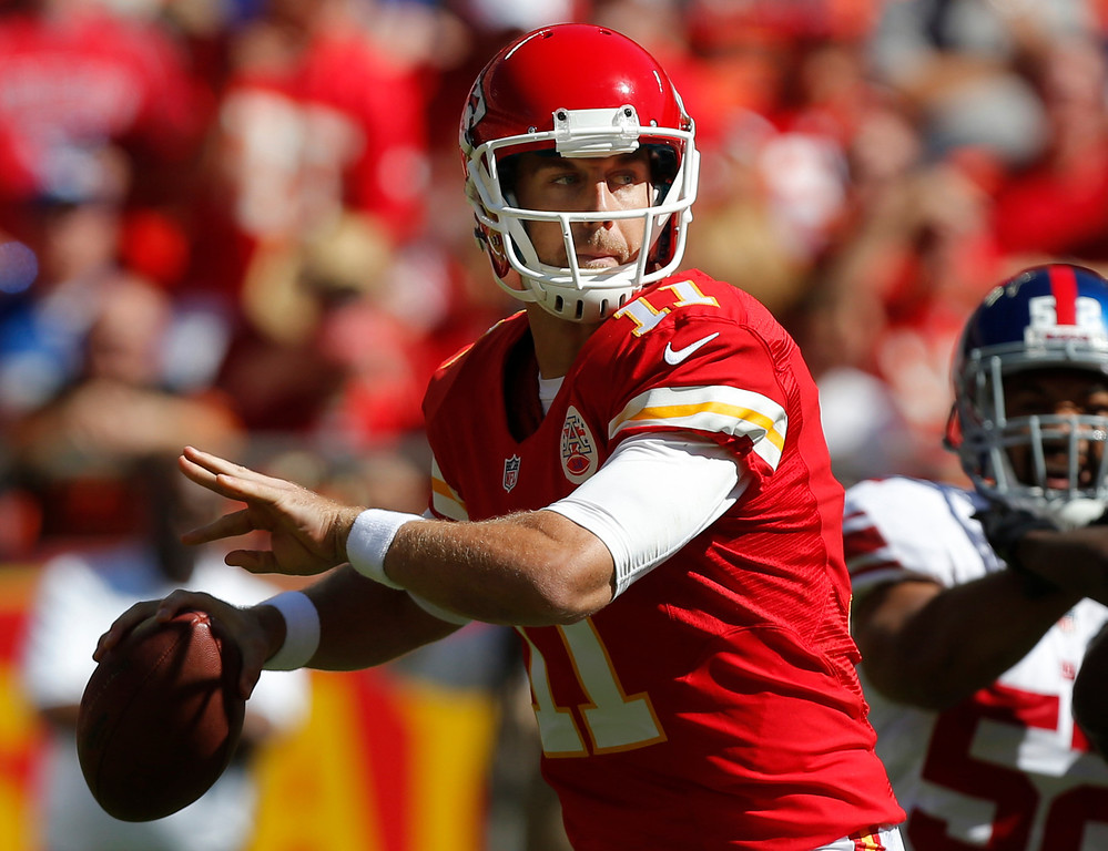 . Kansas City Chiefs quarterback Alex Smith (11) looks for a receiver during the first half of an NFL football game against the New York Giants at Arrowhead Stadium in Kansas City, Mo., Sunday, Sept. 29, 2013. (AP Photo/Ed Zurga)
