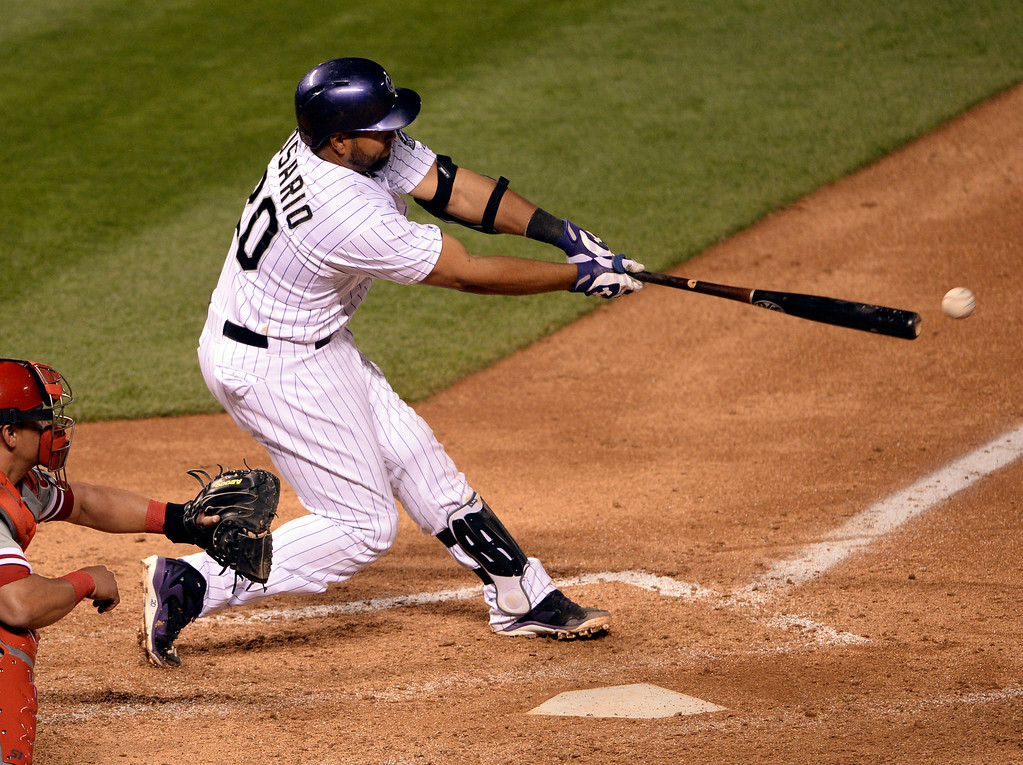 . DENVER, CO - APRIL 18: Colorado batter Wilin Rosario doubled in two runs in the eighth inning. The Colorado Rockies defeated the Philadelphia Phillies 12-1 Friday night, April 18, 2014 at Coors Field.  (Photo by Karl Gehring/The Denver Post)