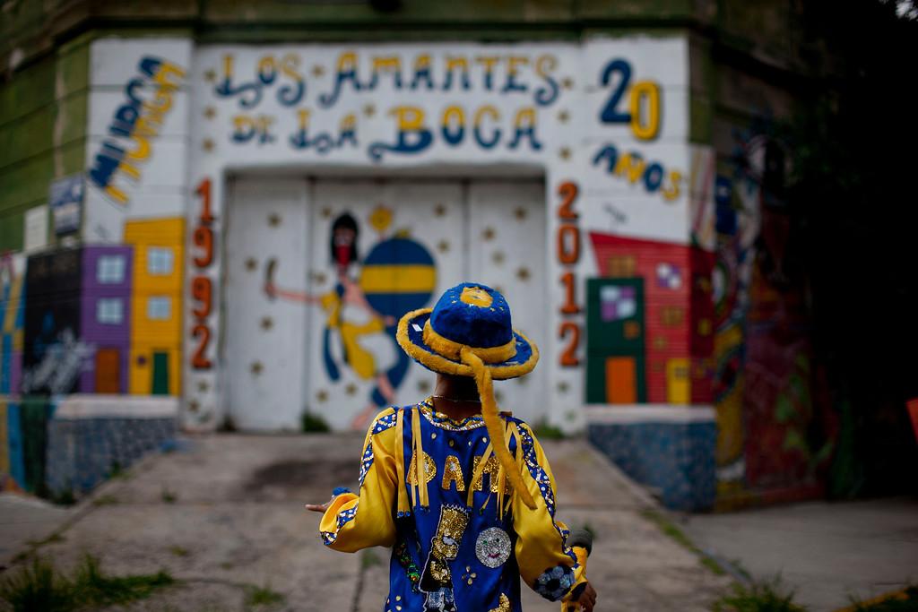 ". Damian Carballo, a member of the murga \""Los amantes de La Boca,\"" walks at the La Boca neighborhood before participating in carnival celebrations in Buenos Aires, Argentina, Saturday, Feb. 2, 2013.  (AP Photo/Natacha Pisarenko)"