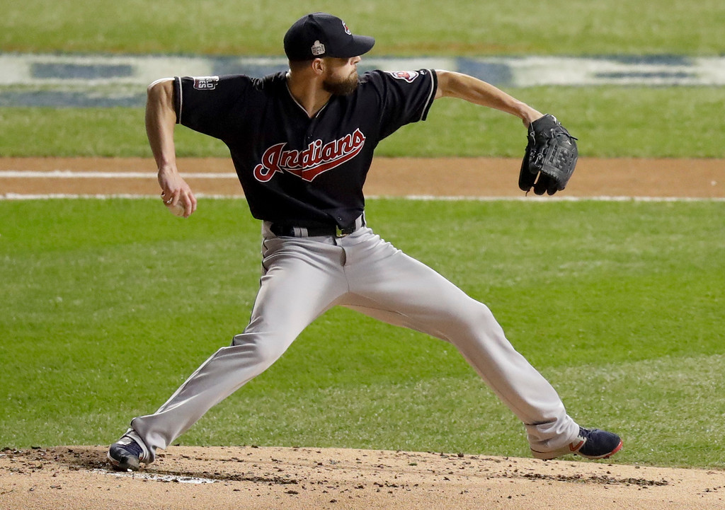 . Cleveland Indians starting pitcher Corey Kluber throws against the Chicago Cubs during the first inning of Game 4 of the Major League Baseball World Series Saturday, Oct. 29, 2016, in Chicago. (AP Photo/Charles Rex Arbogast)
