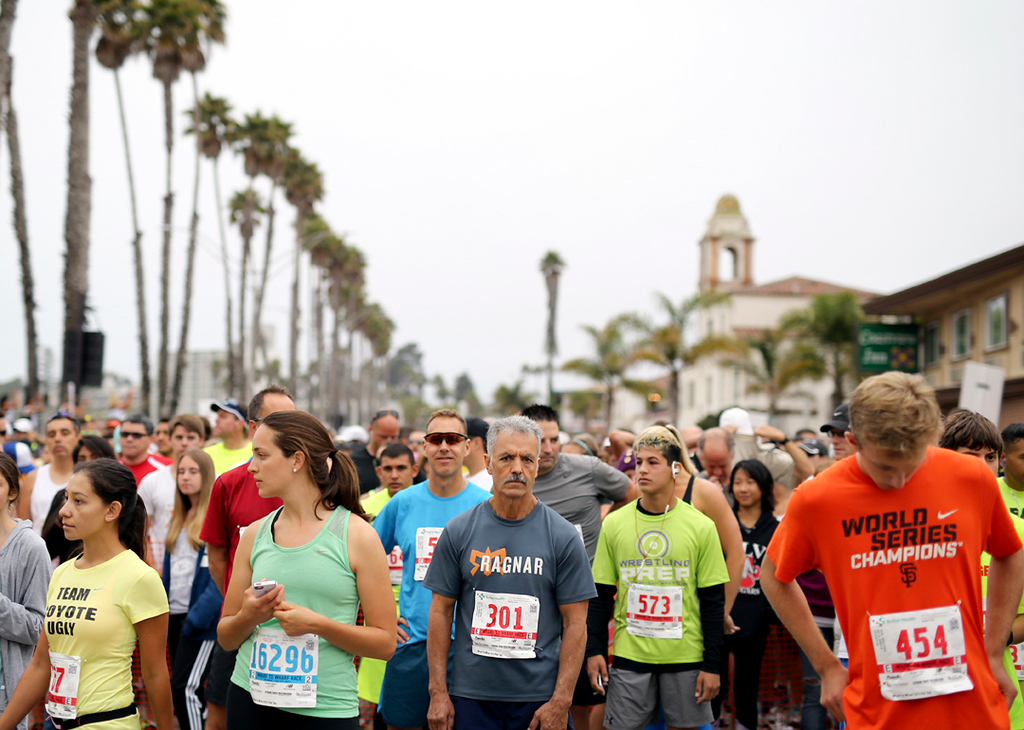 . Runners line the starting line of the Wharf to Wharf race in Santa Cruz on Sunday morning. (Kevin Johnson -- Santa Cruz Sentinel)