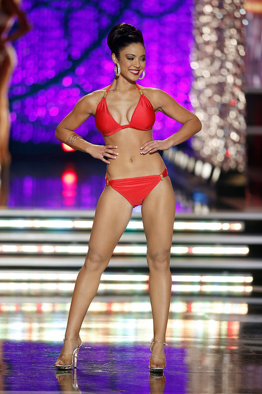 . Miss Iowa Mariah Cary competes in the swimsuit portion of the Miss America 2013 pageant on Saturday, Jan. 12, 2013, in Las Vegas. (AP Photo/Isaac Brekken)