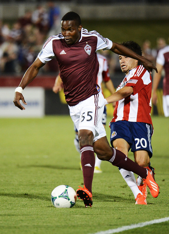 . COMMERCE CITY, CO. - MAY 25: Danny Mwanga of Colorado Rapids controls the ball against Carlos Alvarez of Chivas USA in the 2nd half of the game at Dick\'s Sporting Goods Park. Commerce City, Colorado. May 25, 2013. Colorado won 2-0. (Photo By Hyoung Chang/The Denver Post)
