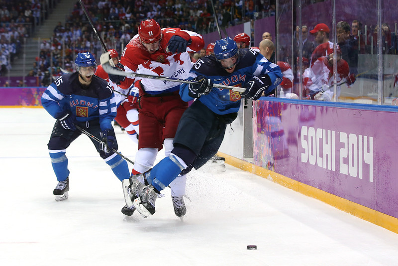 . Yevgeni Malkin #11 of Russia knocks Sami Vatanen #45 of Finland into the boards during the Men\'s Ice Hockey Quarterfinal Playoff on Day 12 of the 2014 Sochi Winter Olympics at Bolshoy Ice Dome on February 19, 2014 in Sochi, Russia.  (Photo by Bruce Bennett/Getty Images)