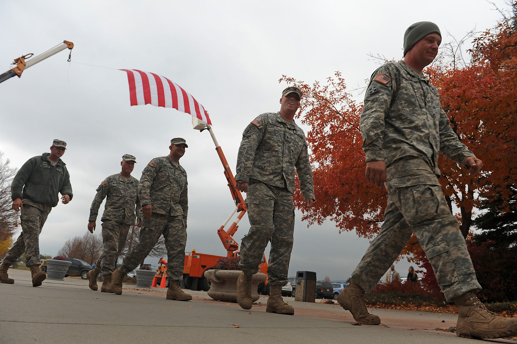 . LONGMONT, CO - OCTOBER 29:   Members of the Kansas National Guard arrive at the Life Bridge Community Church in  Longmont, Co on October 29, 2013.  They were coming to be part of a celebration  held to thank members of the military, law enforcement, firefighters and members of Colorado Department of Transportation for all their work during and after the floods.   (Photo By Helen H. Richardson/ The Denver Post)