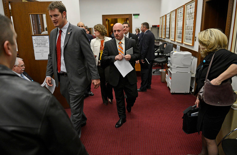 . Mark Kelly, center, the husband of former U.S. Rep. Gabrielle Giffords, walks in to testify before Colorado lawmakers on a universal background check bill for private gun sales, March, 04, 2013, at the Colorado State Capitol. Kelly addressed the Senate State, Veterans, and Military Affairs Committee in support of House Bill 1229. (Photo By RJ Sangosti/The Denver Post)