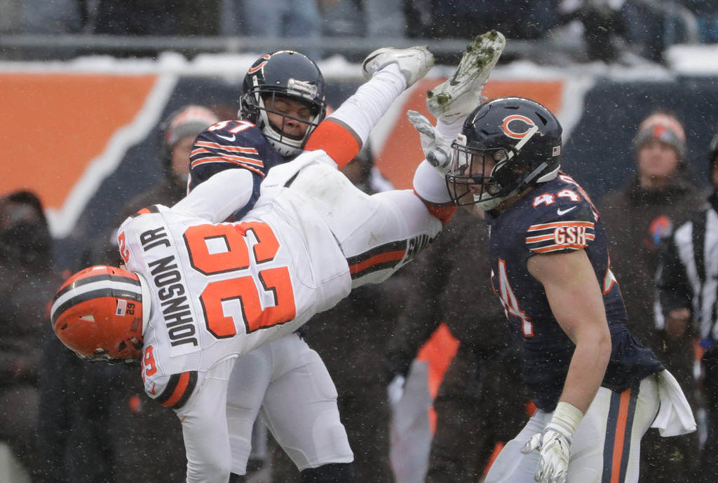 . Cleveland Browns running back Duke Johnson (29) is tackled by Chicago Bears cornerback Bryce Callahan (37) as Chicago Bears inside linebacker Nick Kwiatkoski (44) assists in the second half of an NFL football game in Chicago, Sunday, Dec. 24, 2017. (AP Photo/Nam Y. Huh)