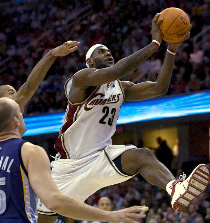 . MORNING JOURNAL/DAVID RICHARD LeBron James goes to the basket last night against Memphis.