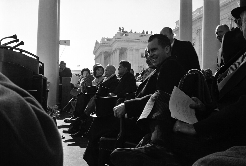 . This was the view of front row seats in the inaugural stand before administration of Democrat  John F. Kennedy  took over from that of Republican President Dwight  Eisenhower.   From left: Mrs. Lyndon B. Johnson, wife of new vice-president; Mrs. John F. Kennedy , wife of president-elect; Eisenhower;  John F. Kennedy, who took oath as president a few minutes later.    Lyndon B. Johnson, the new vice president.   At right is  Vice President Richard Nixon who was Kennedy\'s opponent in the election.   (AP Photo)