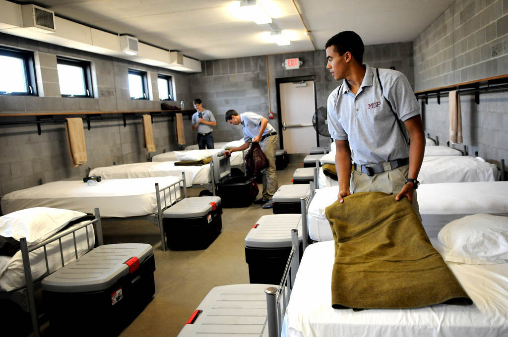 ". Tyler Hemp, 17, of Bemidji, folds the blanket on his bed during a Minnesota State Patrol High School Summer Camp at Camp Ripley, near Little Falls. ""I\'m here \'cause I feel that this is what I want to do with my future,\"" said Hemp.  (Pioneer Press: Jean Pieri)"