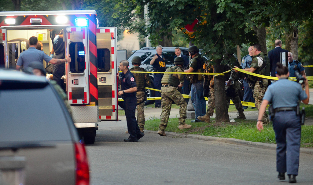 . An ambulance is parked and readied moments before Brian Fitch St. was shot and apprehended in St. Paul on Wednesday. (Pioneer Press: Ben Garvin)