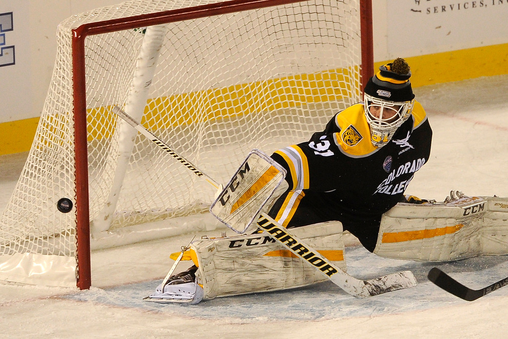 . Colorado College goalie Jacob Nehama (31) stretches out to deflect a puck during the second period at Coors Field in Denver, Colorado on February 20, 2016. (Photo by Seth McConnell/The Denver Post)